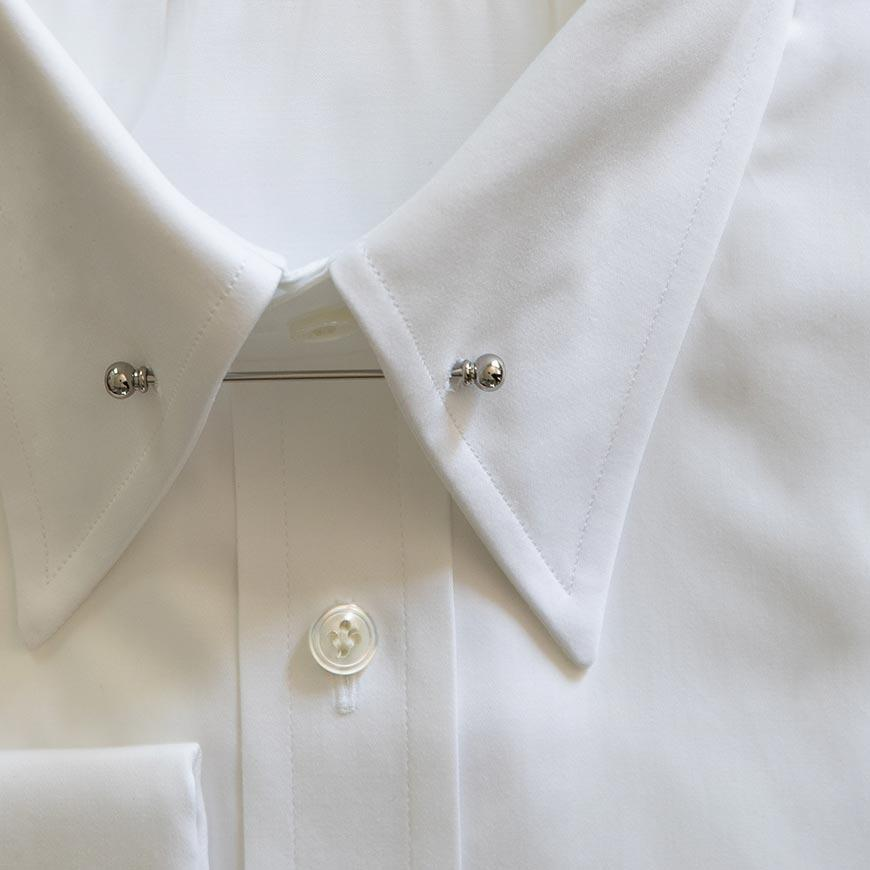 White shirt with pin