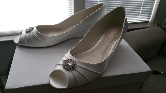 White bridal shoes with ornaments